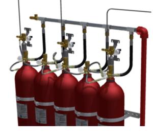 Widok na przykładowy zestaw butli z podłączonymi element systemu.